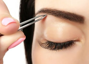 depositphotos_76546271-stock-photo-young-woman-plucking-eyebrows-with